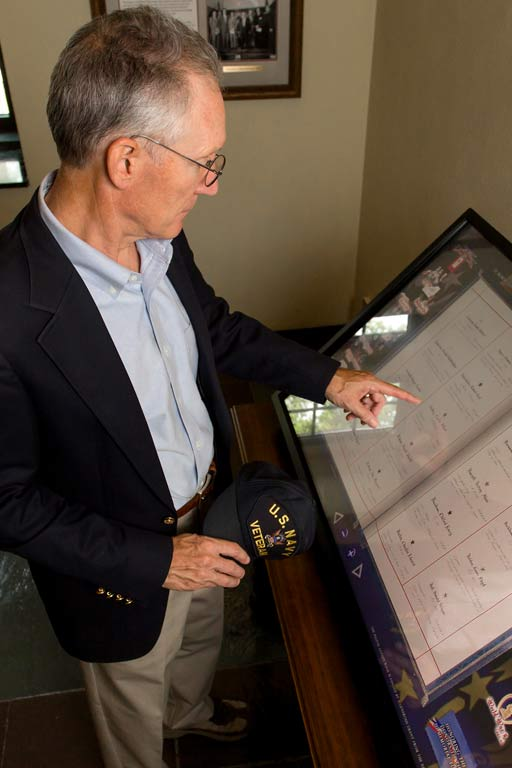 A Navy veteran accesses Golden Book digital records in the Memorial Room