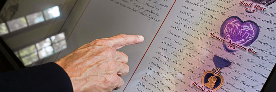 A close up of a hand scanning names in the Golden Book